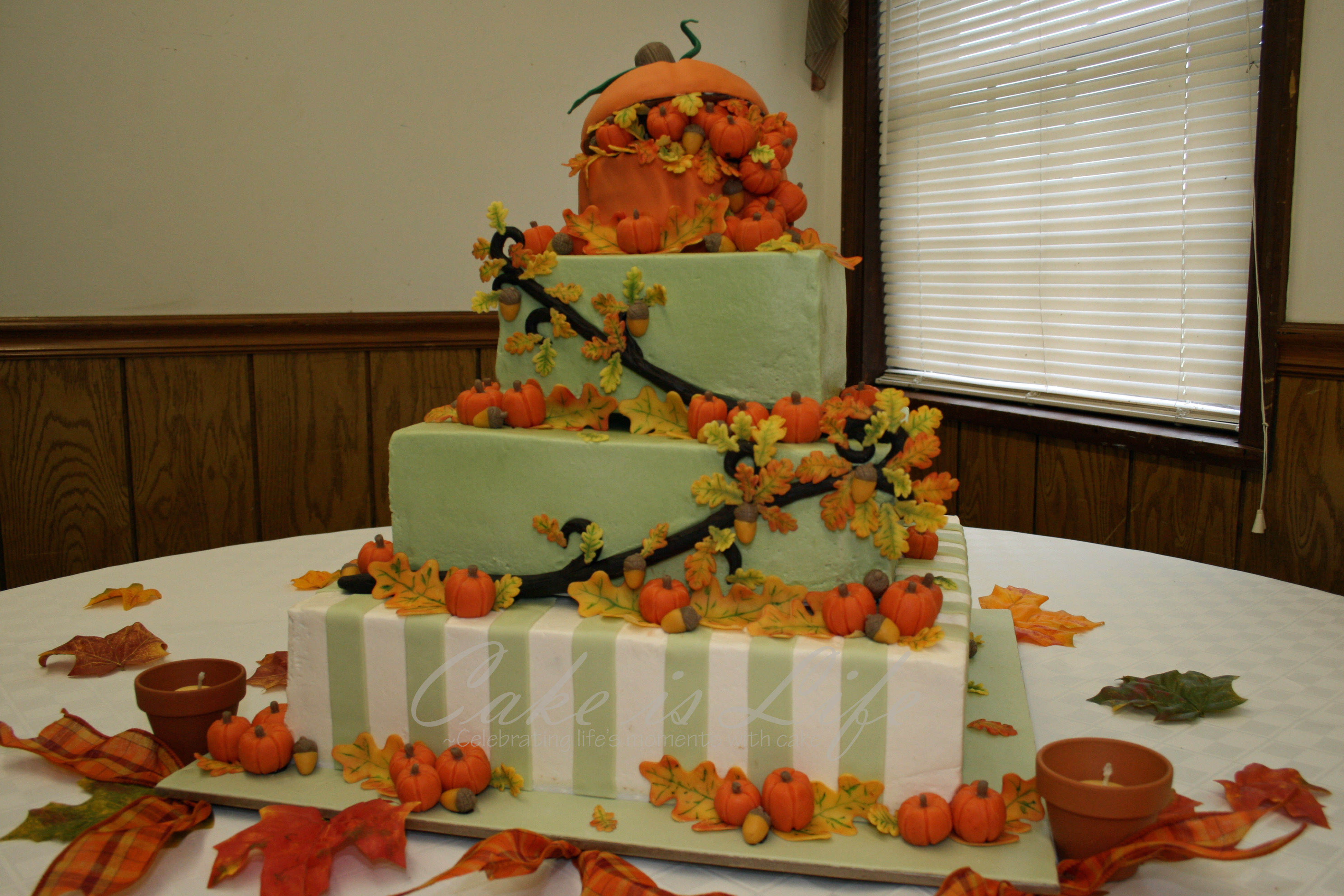 Autumnthemed Wedding Cake The cake is covered in buttercream with