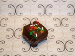 Dark Fluffer: A vanilla marshmallow covered in dark chocolate and topped with holiday jimmies.